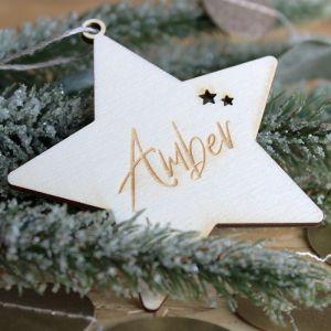 Houten kerstster met naam en sterretjes